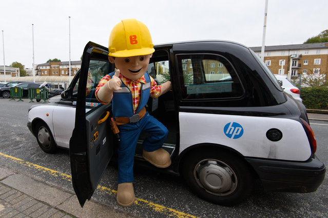 A performer dressed as Bob the Builder departs a London taxi after the Brand Licensing Europe character parade at Olympia Exhibition Centre on October 13, 2015 in London, England. A record number of famous children's characters will take part in this year's character parade during the 17th edition of the annual Brand Licensing Europe exhibition. (Photo by Ben Pruchnie/Getty Images)