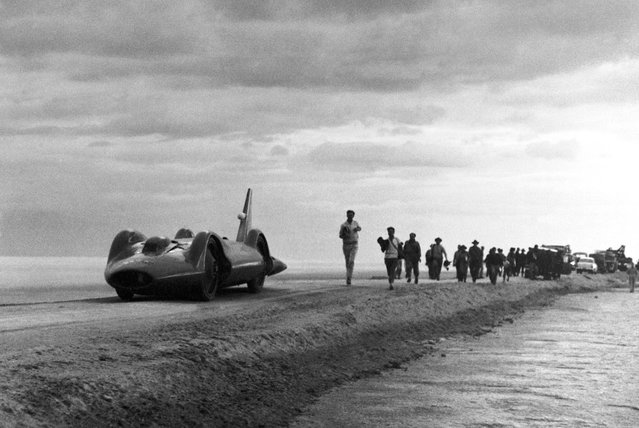 Bluebird, the 5,000 horsepower car in which Donald Campbell hopes to break the world land speed record, pictured during its first run, with Campbell at the controls, during preliminary tests on the specially prepared track at Lake Eyre, South Australia on May 2, 1963. Torrential rains flooded the lake, postponing his run until the following year, when he set a record of 403.10 mph (648.73 km/h). (Photo by AP Photo/HO)