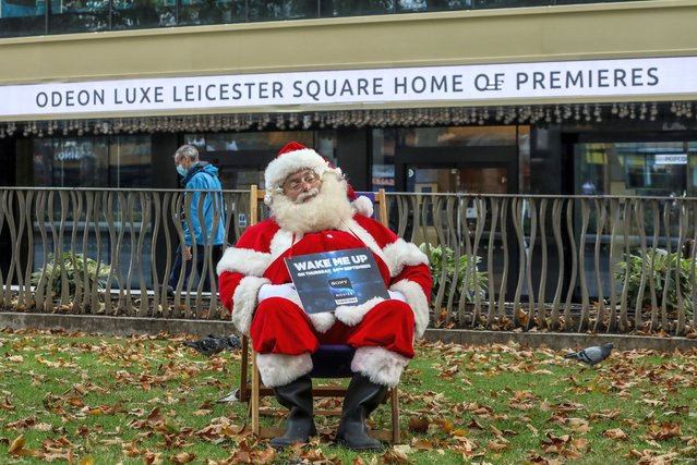 A man dressed as Santa Claus is seen seated in a picnic chair with a poster in his hands around Leicester Square in London to promote the new channel Sony Movies Christmas which launches on Thursday the 24th of September 2020 and will run for the next three months. (Photo by Brett Cove/SOPA Images/Sipa USA)