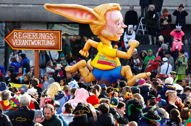 """A carnival float depicting Free Democratic Party (FDP) leader Christian Lindner at the traditional """"Rosenmontag"""" Rose Monday carnival parade in Duesseldorf, Germany on February 12, 2018. (Photo by Thilo Schmuelgen/Reuters)"""