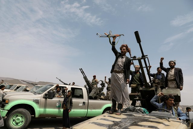 Houthi fighters shout slogans during a gathering of Houthi loyalists on the outskirts of Sanaa, Yemen on July 8, 2020. (Photo by Khaled Abdullah/Reuters)