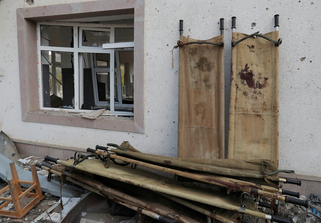 Stretchers are seen outside a hospital, which, according to the Ministry of Foreign Affairs of the Nagorno-Karabakh region, was damaged during recent shelling by Azeri armed forces, in the fighting over the breakaway region of Nagorno-Karabakh, in Martakert on October 15, 2020. (Photo by Reuters/Stringer)