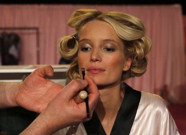 Model Romee Strijd has her make-up applied ahead of the 2014 Victoria's Secret Fashion Show in London December 2, 2014. (Photo by Suzanne Plunkett/Reuters)