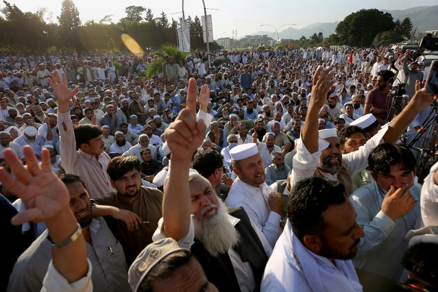 Thousands of government employees stage a sit-in protest in front of the parliament building demanding job regularization, increases in their salaries and other benefits, in Islamabad, Pakistan, Tuesday, October 6, 2020. (Photo by Anjum Naveed/AP Photo)