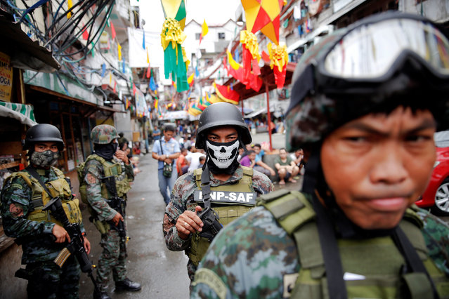 Armed security forces take a part in a drug raid, in Manila, Philippines, October 7, 2016. (Photo by Damir Sagolj/Reuters)