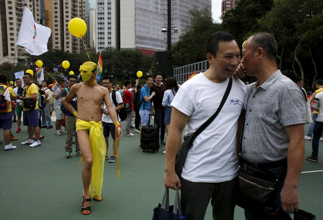 A participant poses as two others chat during the annual pride parade in Hong Kong, China, November 7, 2015. (Photo by Bobby Yip/Reuters)