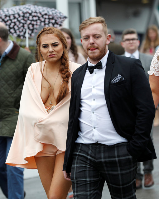 Racegoers during Ladies Day at the Grand National Festival at Aintree Racecourse on April 13, 2018 in Liverpool, England. (Photo by Darren Staples/Reuters)