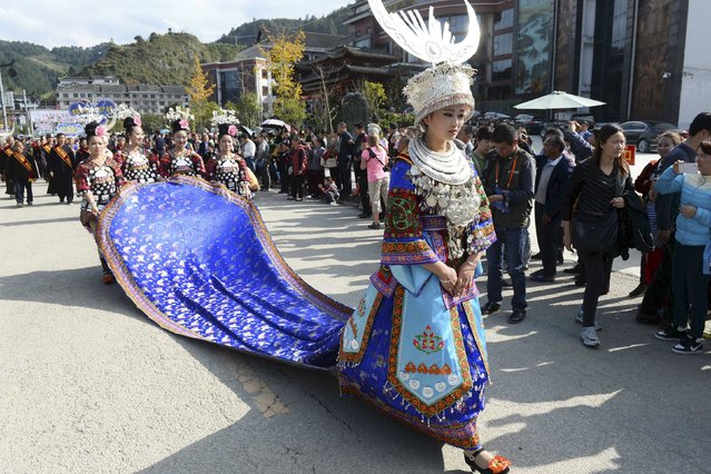 Ethnic Miao minority women in traditional costumes march along a street to celebrate the New Year according to Miao calendar, in Leishan county, Guizhou province, China, November 22, 2015. The Miao's New Year celebrations in Leishan began on Sunday this year and will last until the end of December, according to local media. (Photo by Reuters/China Daily)