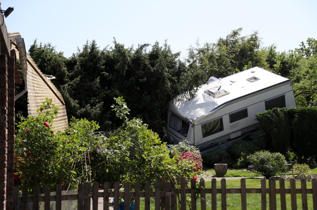 "A caravan trailer is blown into a hedge in Viersen, Germany, 17 May 2018, after what was reported as a ""tornado"" left a swath of destruction near the city around 40 miles west of Dusseldorf. The twister storm reportedly lasted between 10 to 15 minutes and caused severe damage to around 50 houses on its route. (Photo by Bodo Marks/EPA/EFE)"