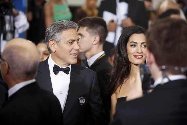 Actor George Clooney and wife, Amal Clooney, arrive at the 72nd Golden Globe Awards in Beverly Hills, California January 11, 2015. (Photo by Danny Moloshok/Reuters)