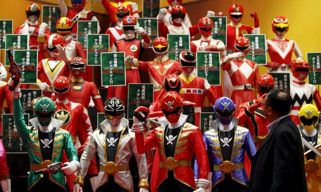 A visitor walks past displays of Japan's television show hero characters at the International Tokyo Toy Show 2011 in Tokyo in this June 16, 2011 file photo.  Japan is expected to release consumer confidence data this week. (Photo by Kim Kyung-Hoon/Reuters)