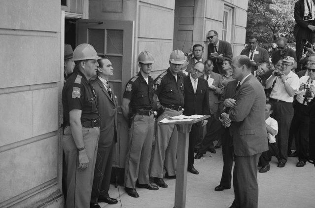 Alabama Governor George Wallace standing defiantly at a door while being confronted by Deputy U.S. Attorney General Nicholas Katzenbach while attempting to block integration at the University of Alabama in Tuscaloosa, June 11, 1963. (Photo by Reuters/Library of Congress)