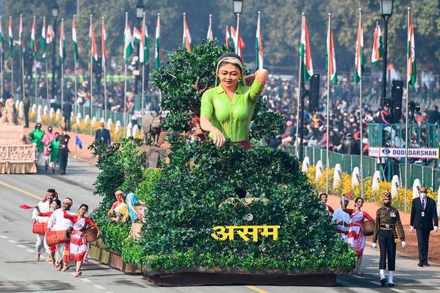 Performers dance next to a float representing Assam on Rajpath during the Republic Day parade in New Delhi on January 26, 2021. (Photo by  Jewel Samad/AFP Photo)