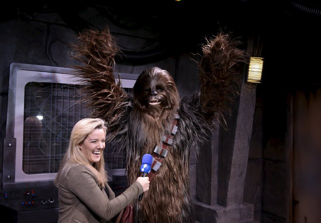 The character Chewbacca reacts to a television reporter during the Star Wars Launch Bay grand opening at Disney's Hollywood Studios in Orlando, Florida December 4, 2015. (Photo by Scott Audette/Reuters)