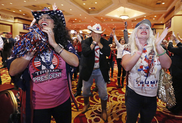 Diana Caldon, from left, Eddie Hamilton and Stephanie Smith celebrate at an election night watch party hosted by the Nevada GOP as Donald Trump wins the presidency Tuesday, November 8, 2016, in Las Vegas. (Photo by Ronda Churchill/AP Photo)