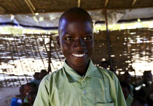 Mohamed Ali Ishag, a 4th grader at the Ardamata camp for the internally displaced poses for a photograph in El-Geneina in West Darfur, Sudan, November 24, 2015. Born in the camp, 12 years old Ishag wishes to be air craft engineer in his adulthood. The conflict in Sudan's Darfur region that erupted 12 years ago shows no sign of ending. (Photo by Mohamed Nureldin Abdallah/Reuters)