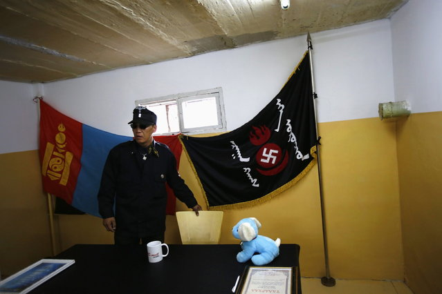 Ariunbold, a leader of the Mongolian neo-Nazi group Tsagaan Khass, arrives at the group's headquarters in Ulan Bator June 24, 2013. (Photo by Carlos Barria/Reuters)