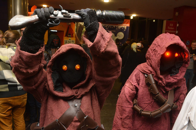 "Members of a Star Wars fan club wear costumes of movie characters as they join a midnight premiere of the new Star Wars movie ""Star Wars: The Force Awakens"" at a cinema in Stuttgart, Germany, late 16 December 2015 night. Numerous fans of the science fiction movie series were gathering to attend one of the midnight premiere screenings all over Germany of the latest movie of the epic series – ""Star Wars: The Force Awakens"". (Photo by Nikolai Huland/EPA)"
