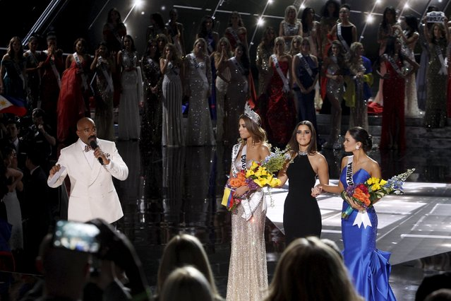 Host Steve Harvey (far L) speaks as Miss Colombia Ariadna Gutierrez (L), Miss Universe 2014 Paulina Vega (C) and Miss Philippines Pia Alonzo Wurtzbach listen onstage during the 2015 Miss Universe Pageant in Las Vegas, Nevada, December 20, 2015. Miss Colombia was originally announced as the winner but Harvey said he made a mistake when reading the card. Miss Philippines Pia Alonzo Wurtzbach is the actual winner. (Photo by Steve Marcus/Reuters)