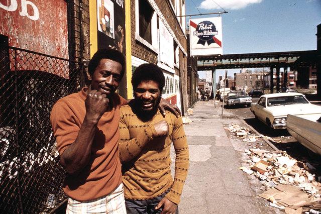 Men pose on a South Side street, May 1974. (Photo by John H. White/NARA via The Atlantic)