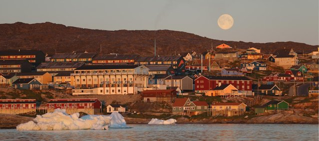 The village of Ilulissat, near icebergs from Jakobshavn Glacier, on July 24, 2013. (Photo by Joe Raedle/Getty Images via The Atlantic)