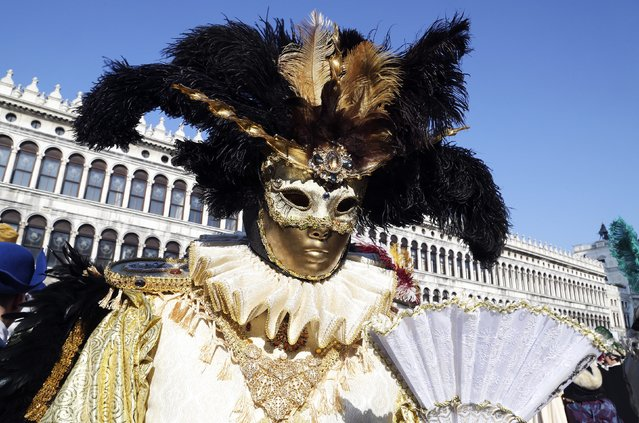 A masked reveller poses in Saint Mark square during carnival in Venice February 8, 2015. (Photo by Stefano Rellandini/Reuters)