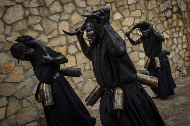 People with his face covered in oil and soot and carrying bull horns representing a devil join a carnival festival on February 14, 2015 in Luzon, Spain. (Photo by David Ramos/Getty Images)