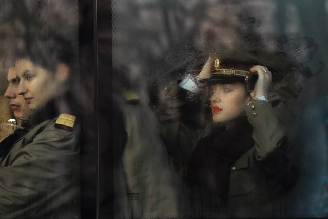 Romanian military doctors and medical students sit on a bus behind steamy windows before the National Day parade in Bucharest, Romania, Thursday, December 1, 2016. (Photo by Vadim Ghirda/AP Photo)