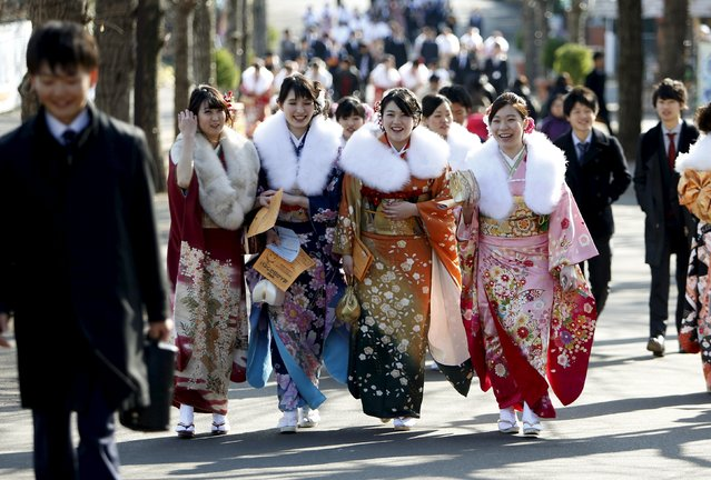 Japanese women wearing kimonos walk as they attend a Coming of Age Day celebration ceremony at an amusement park in Tokyo January 11, 2016. (Photo by Yuya Shino/Reuters)