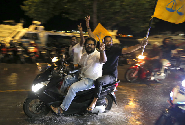 Supporters of Maldives' opposition presidential candidate Ibrahim Mohamed Solih celebrate their victory in Male, Maldives, Monday, September 24, 2018. A longtime but little-known lawmaker Solih declared victory at his party's campaign headquarters in the capital city Male in a contentious election widely seen as a referendum on the island nation's young democracy. (Photo by Eranga Jayawardena/AP Photo)