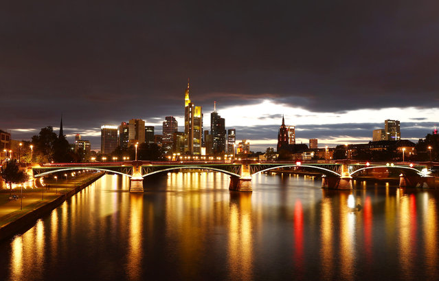 The skyline with its financial district is photographed during sunset as the spread of the coronavirus disease (COVID-19) continues in Frankfurt, Germany, October 11, 2020. (Photo by Kai Pfaffenbach/Reuters)