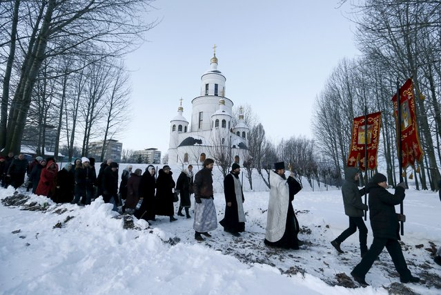 People take part in a procession as part of celebrations for Orthodox Epiphany in Minsk, January 19, 2016. (Photo by Vasily Fedosenko/Reuters)