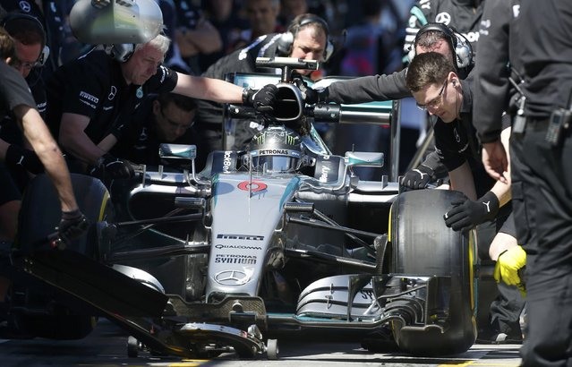 Mercedes Formula One driver Nico Rosberg of Germany makes a pit stop during the first practice session of the Australian F1 Grand Prix at the Albert Park circuit in Melbourne March 13, 2015. REUTERS/Brandon Malone