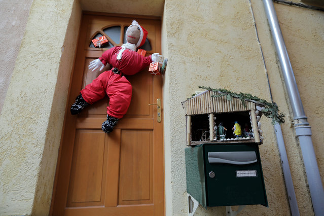 A Nativity scene is seen on a letter box in front of a house in the medieval mountain village of Luceram as part of Christmas holiday season, France, December 15, 2016. (Photo by Eric Gaillard/Reuters)
