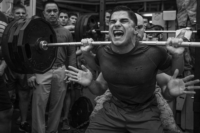 Jace Manning, Marine Medium Tiltrotor Squadron (VMM) 263 (Reinforced), 22nd Marine Expeditionary Unit (MEU), air traffic control staff noncommissioned officer in charge and native of Belton, Texas, squats 385 pounds during a weight-lifting competition aboard the USS Bataan (LHD 5), at sea, April 20, 2014. (Photo by Sgt. Austin Hazard/U.S. Marine Corps)
