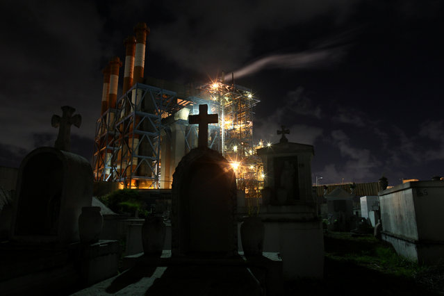 Central Palo Seco power station of the Puerto Rico Electric Power Authority (PREPA) is seen behind a cemetery, in San Juan, Puerto Rico January 22, 2018. (Photo by Alvin Baez/Reuters)