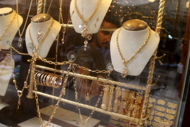 Gold jewelry is displayed for sale in Al-Shaar neighborhood of Aleppo, Syria September 7, 2015. (Photo by Abdalrhman Ismail/Reuters)