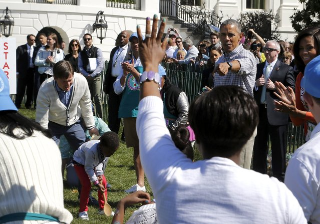 U.S. President Barack Obama (2nd R) and first lady Michelle Obama (R) cheer on children during the annual Easter Egg Roll at the White House in Washington April 6, 2015. (Photo by Jonathan Ernst/Reuters)
