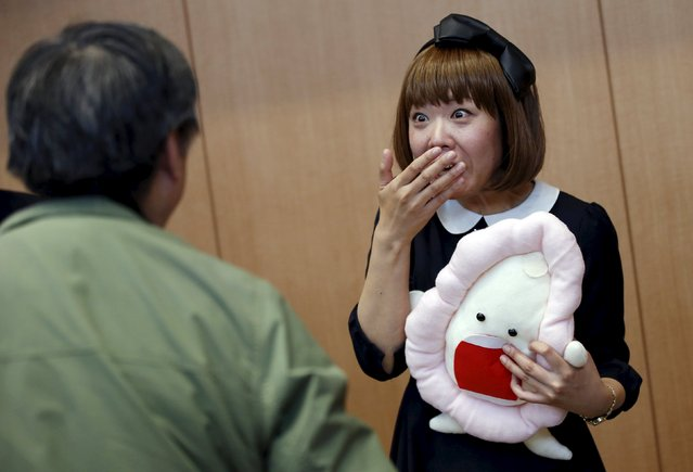 Japanese artist Megumi Igarashi (R), known as Rokudenashiko, holding her v*gina-inspired artwork, reacts to a photographer after a news conference following a court appearence in Tokyo April 15, 2015. (Photo by Toru Hanai/Reuters)