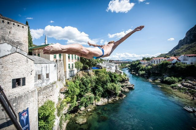 In this handout image provided by Red Bull, Andy Jones of the USA dives from the 21 metre Stari Most (Old Bridge) during the first competition day of the third stop of the Red Bull Cliff Diving World Series on August 26, 2021 at Mostar, Bosnia and Herzegovina. (Photo by Romina Amato/Red Bull via Getty Images)