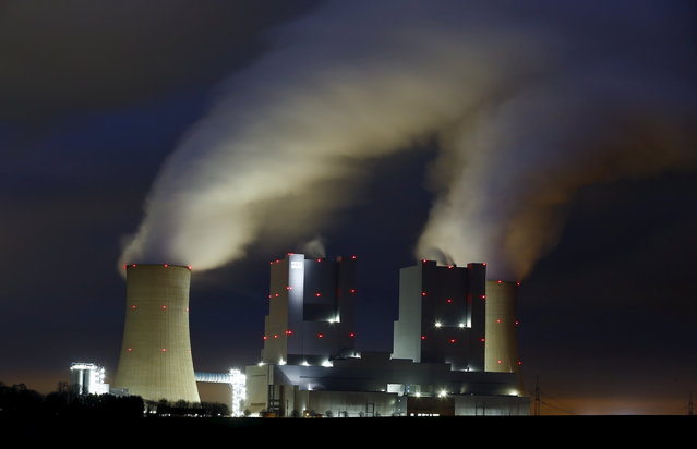 Steam rises from the chimneys of the coal power plant of RWE in Neurath, Germany, March 4, 2016. (Photo by Wolfgang Rattay/Reuters)