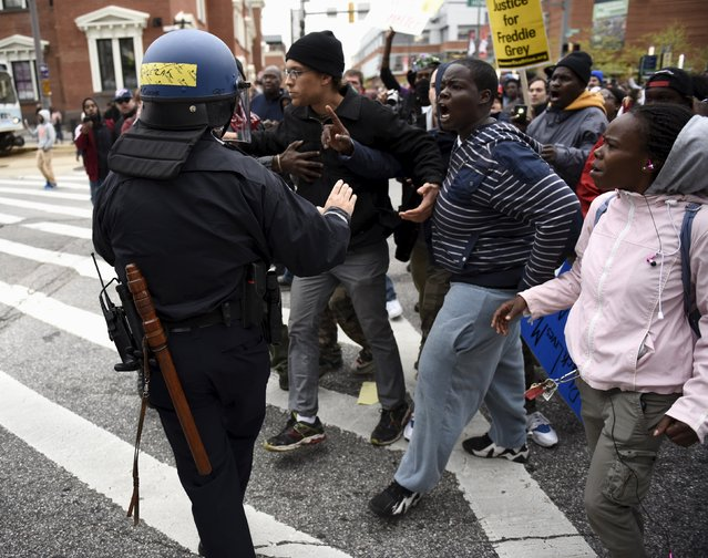Demonstrators confront police as they gather near Camden Yards to protest the death in police custody of Freddie Gray in Baltimore April 25, 2015. The U.S. Justice Department is looking into the case of Gray, who was arrested on April 12 and a week later in a hospital after slipping into a coma, a spokeswoman said. (Photo by Sait Serkan Gurbuz/Reuters)
