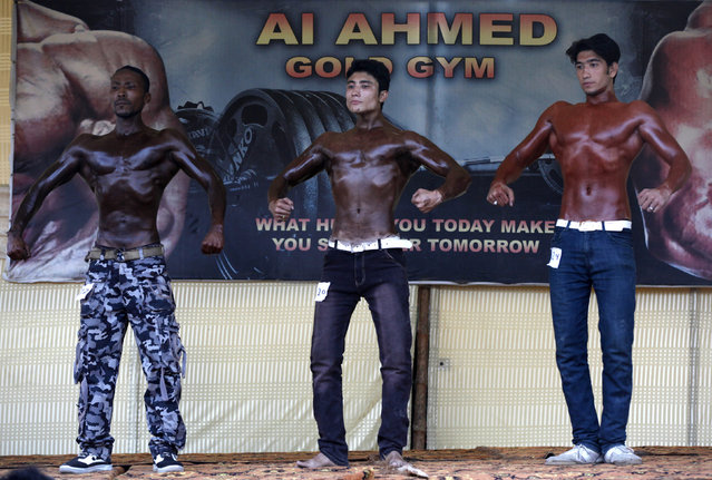 Participants pose during a local bodybuilding and fitness championship in Karachi, Pakistan March 13, 2016. (Photo by Akhtar Soomro/Reuters)