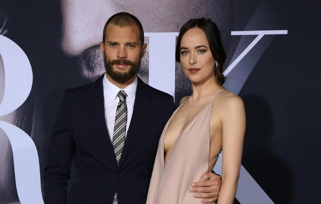 """Actors Jamie Dornan and Dakota Johnson arrive at the premiere of Universal Pictures' """"Fifty Shades Darker"""" at The Theatre at Ace Hotel on February 2, 2017 in Los Angeles, California. (Photo by Splash News and Pictures)"""