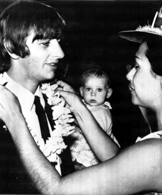 The Beatle's drummer Ringo Starr receives Hawaii's traditional welcoming lei from official greeter Noni Kuhns at Honolulu Airport, June 12, 1964. Starr had been ill and was re-joining the other Beatles in Australia via a short stop in Hawaii. (Photo by AP Photo)