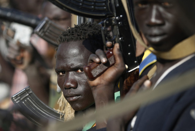 Jikany Nuer White Army fighters hold their weapons in Upper Nile State, South Sudan, on February 10, 2014. (Photo by Goran Tomasevic/Reuters)