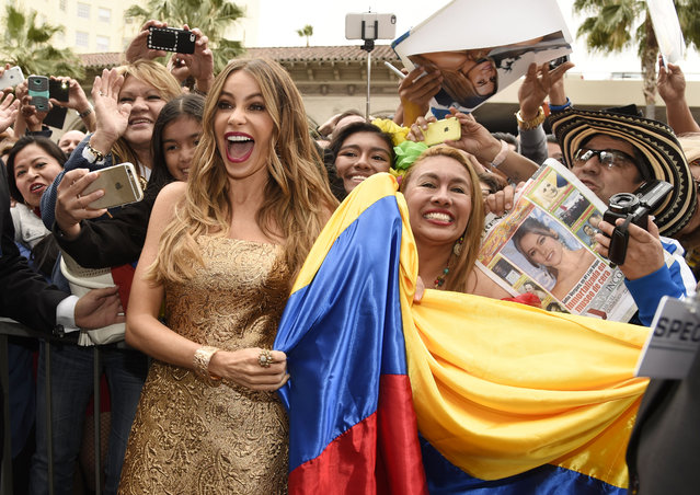 Colombian actress Sofia Vergara poses with fans holding a Colombian flag after she received a star on the Hollywood Walk of Fame on Thursday, May 7, 2015, in Los Angeles. (Photo by Chris Pizzello/Invision/AP Photo)