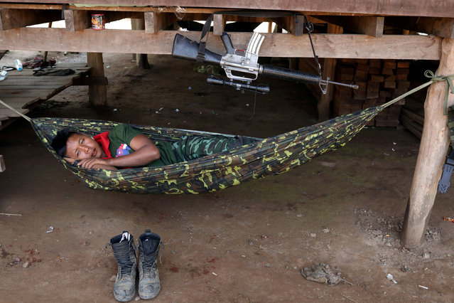 A soldier of Karen National Union (KNU) takes a rest during the 70th anniversary of Karen National Revolution Day in Kaw Thoo Lei, Kayin state, Myanmar on January 31, 2019. (Photo by Ann Wang/Reuters)