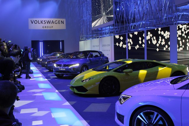 The new Lamborghini Huracan, in yellow, during a preview show of Volkswagen Group, as part of the 84th Geneva International Motor Show, Switzerland, Monday, March 3, 2014. (Photo by Laurent Cipriani/AP Photo)