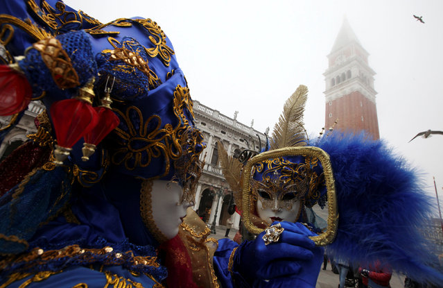 A masked reveller poses during the Venice Carnival in Venice, Italy February 17, 2017. (Photo by Fabrizio Bensch/Reuters)